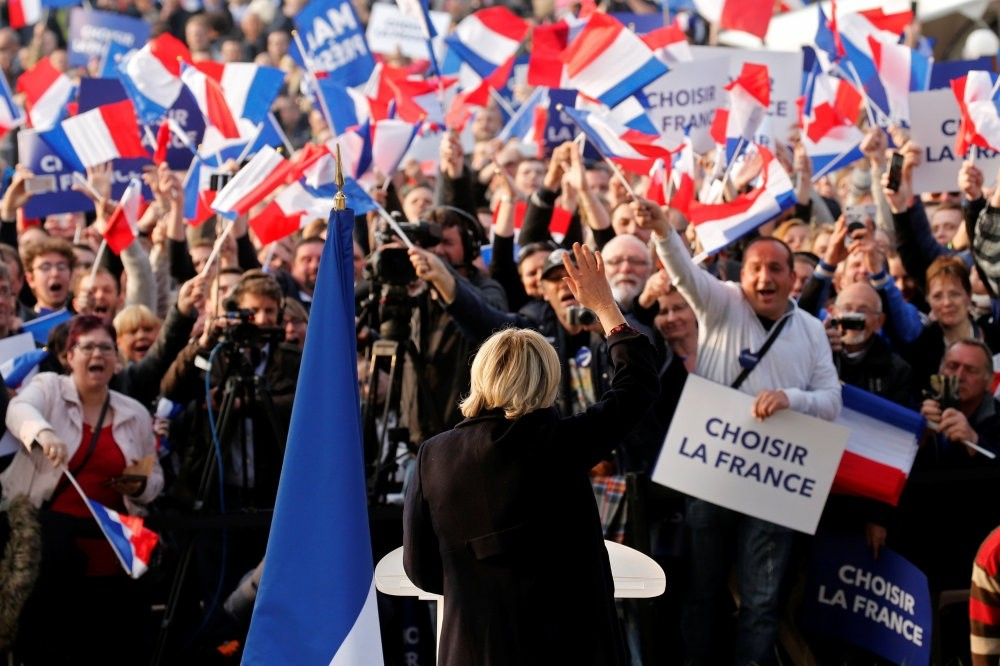Marine Le Pen, an extremist far-right candidate for the 2017 French presidential election, attending a ,people's party, with supporters in Ennemain, northern France, May 4.