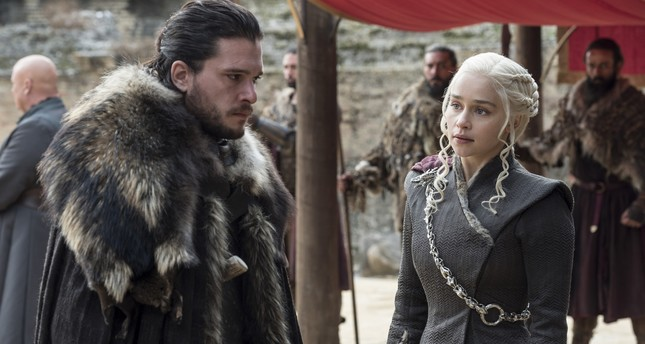 This image released by HBO shows Kit Harington, left, and Emilia Clarke on the season finale of Game of Thrones. (AP Photo)