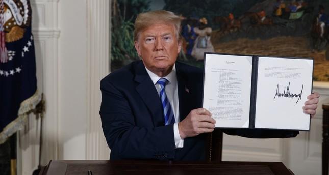 U.S. President Donald Trump shows a signed Presidential Memorandum at the White House, Washington, D.C., May 8, 2018.
