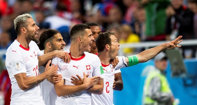 Switzerland's midfielder Granit Xhaka, center, celebrates with his teammates after scoring the 1-1 equalizer during the FIFA World Cup 2018 group E football match between Switzerland and Serbia in Kaliningrad, Russia, June 22, 2018. (EPA Photo)