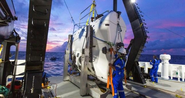 A technician checks the submarine DSV Limiting Factor aboard the research vessel DSSV Pressure Drop above the Pacific Ocean's Mariana Trench in an undated photo released by the Discovery Channel May 13, 2019. (Reuters Photo)