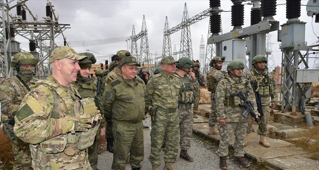 Turkish and Russian soldiers inspect a power facility at Ayn Isa village to provide electricity from the Tishrin Dam to Tel Abyad and Ras al-Ayn AA Photo