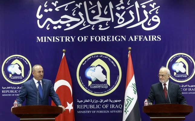 Foreign Minister Mevlüt Çavuşoğlu (L) during a press conference with Iraqi Foreign Minister Ibrahim al-Jaafari in Baghdad, Aug. 23.