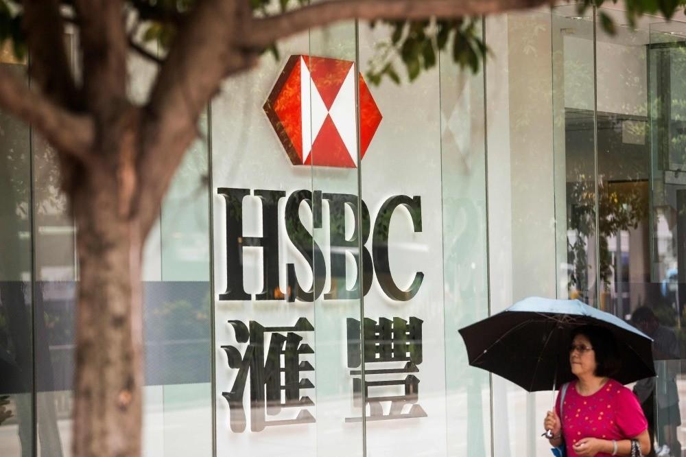 A pedestrian walks past an HSBC signage in the Admiralty district, Hong Kong.