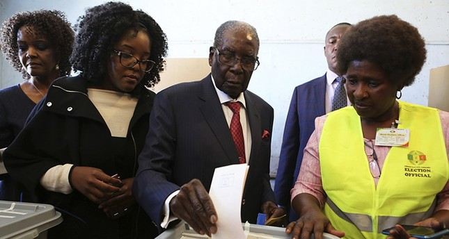 Former Zimbabwean Leader President Robert Mugabe casts his vote at a polling station in Harare, Zimbabwe, Monday, July 30, 2018. (AP Photo)