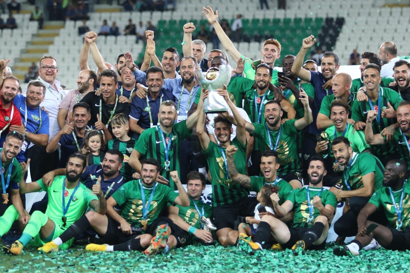 Akhisarspor players celebrate winning the Turkish Super Cup after  beating  Galatasaray 5-4 in penalties at New Konya Stadium on Sunday.