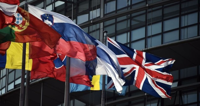The British Union Jack (R) flies among European Union member countries' national flags in front of European Parliament in Strasbourg, France, June 9.