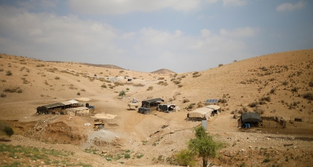 Palestinian Bedouin homes are seen in the Israeli-occupied West Bank, Wednesday, Sept. 11, 2019 (AP Photo)