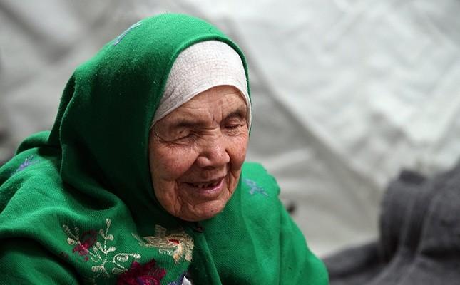 105-year old Afghan refugee Bibikhal Uzbek from Kunduz, Afghanistan, rests in Croatia's main refugee camp at Opatovac, Croatia, near the border with Serbia, Tuesday, Oct. 27, 2015. (AP Photo)