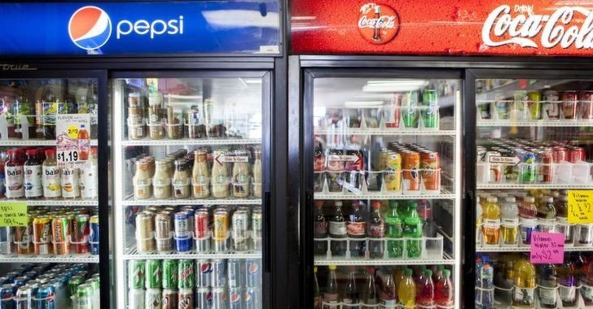 Cans of soda are displayed in a case at Kwik Stops Liquor in San Diego, California February 13, 2014. (Reuters Photo)
