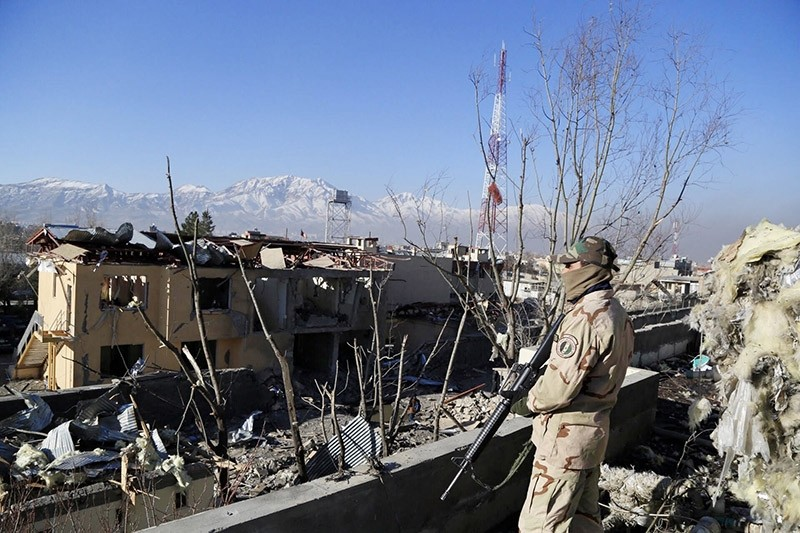 Afghan security officials secure the site of a bomb blast that targeted the district police headquarters after an overnight attack by the Taliban in Kabul, Afghanistan. (EPA File Photo)