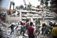 Rescuers labored against long odds into the dawn on Thursday to save a 12-year-old schoolgirl and untold other survivors who may be trapped beneath crumpled buildings in central Mexico following...