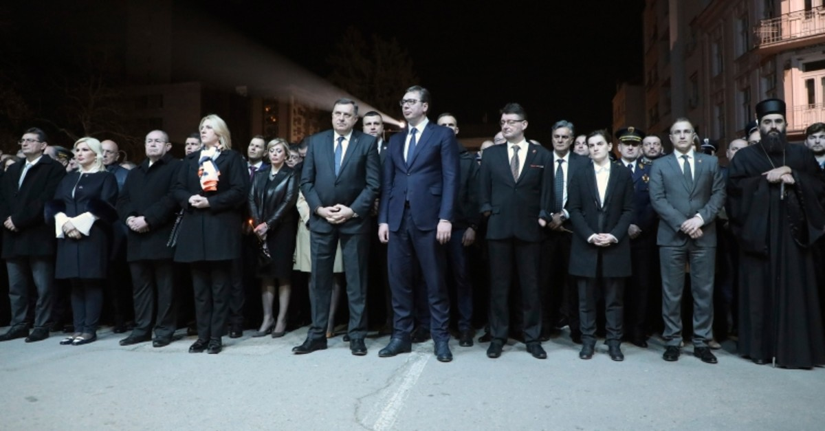 In this photo provided by the Serbian gov't, President Aleksandar Vucic, centre, along with other dignitaries, attend a remembrance ceremony to mark the twentieth anniversary of the 1999 NATO intervention, in Nis, Serbia, Sunday, March 24, 2019.