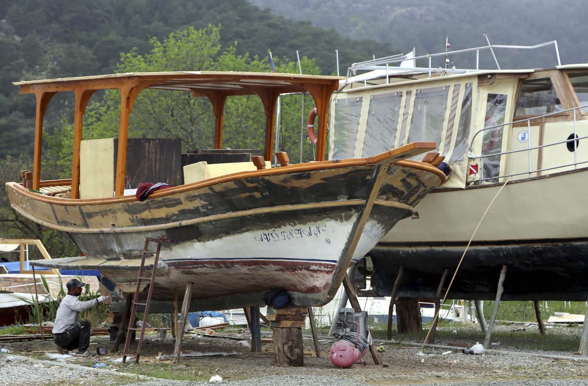 Tour boats on the Dalyan Canal are put under meticulous maintenance at the local boat yard.