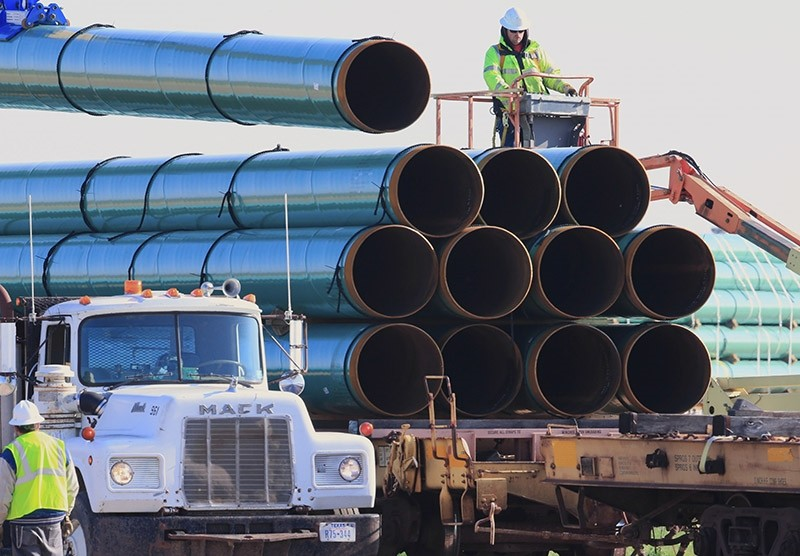 In this May 9, 2015, file photo, workers unload pipes for the proposed Dakota Access oil pipeline that would stretch from the Bakken oil fields in North Dakota to Illinois. (AP Photo)