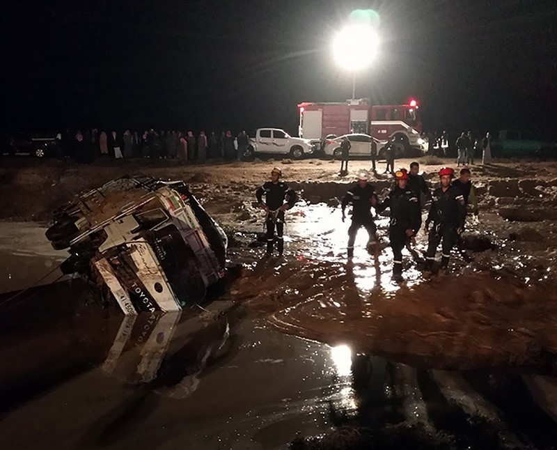 A handout photo made available by  the Jordanian News Agency Petra shows members of the Jordanian civil protection services working on a road that was damaged by flash floods, near Madaba, some 30 km south of Amman, Jordan, Nov. 9, 2018. (EPA Photo)