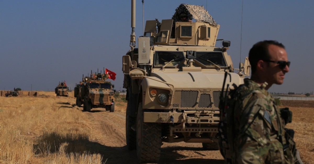 This Friday, Oct. 4, 2019 file photo, Turkish and American armored vehicles patrol as they conduct joint ground patrol in the so-called ,safe zone, on the Syrian side of the border with Turkey, near the town of Tal Abyad (AP Photo)