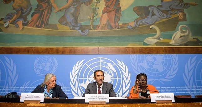 Members of the United Nations (UN) Commission of Inquiry on Burundi,Francoise Hampson of Britain, Commission Presiden Fatsah Ouguergouz of France and Reine Alapini-Gansou of Benin attend a press conference on the commission's report on September 4, 2