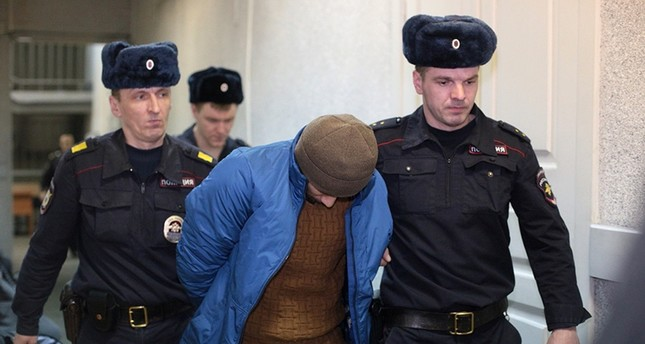 Guards escort a suspect into a court hearing in St. Petersburg, Russia, Thursday, April 6, 2017 (AP Photo)