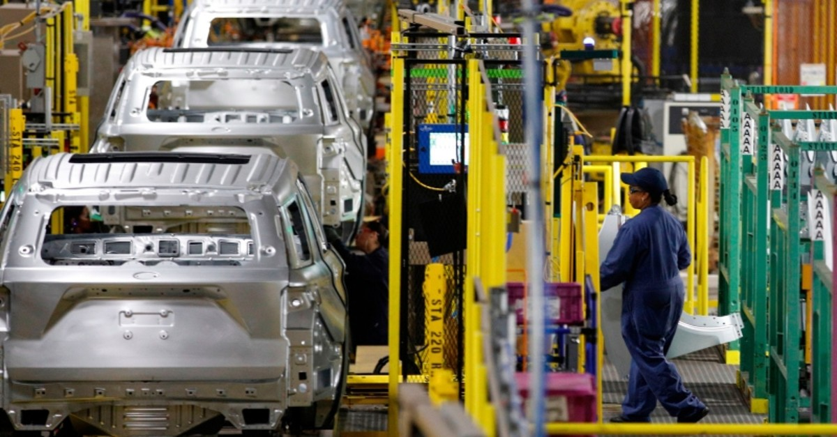 In this file photo taken on June 24, 2019 workers assemble cars at the newly renovated Ford's Assembly Plant in Chicago. (AFP Photo)