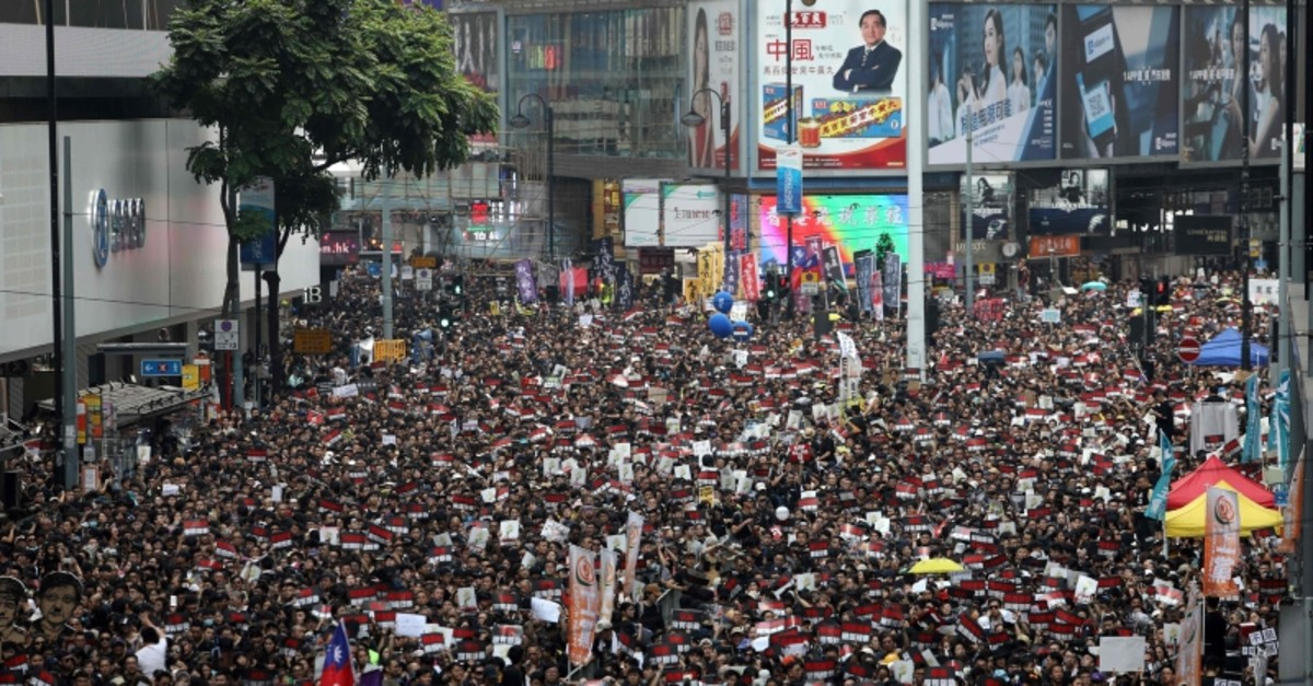 Thousands of protesters dressed in black take part in a new rally against a controversial extradition law proposal in Hong Kong on June 16, 2019. (AP Photo)