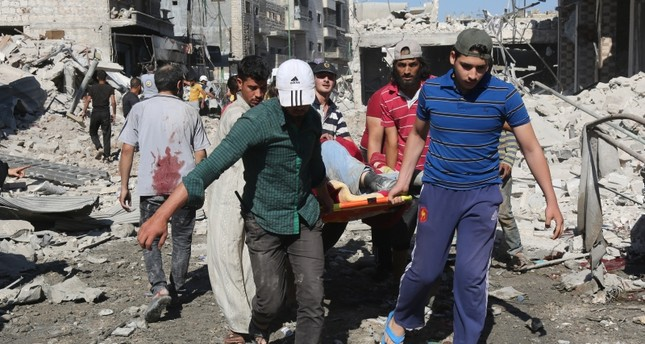 Russian jets strike Idlib market, killing 50 civilians