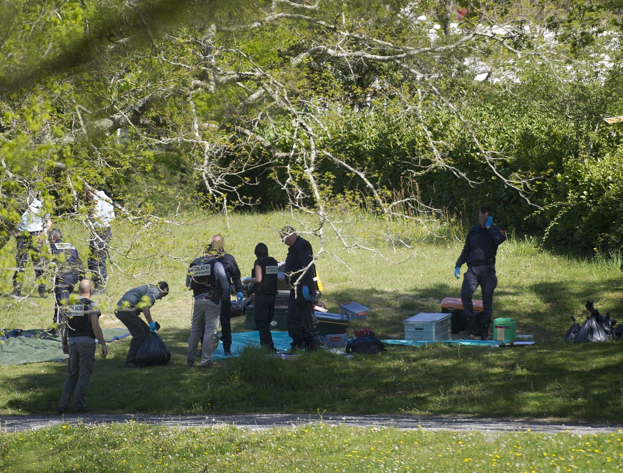 Police forces and demining team officers identify weapons handed by Basque separatist group ETA on April 8, 2017. (AFP PHOTO)