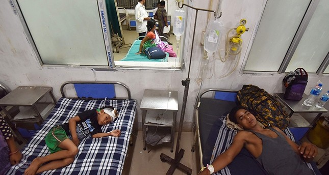 Indian villagers who were injured in a militant attack at Balajan Tinali, receive medical attention at Barpeta Medical College Hospital in Barpeta on August 5, 2016 (AFP Photo)