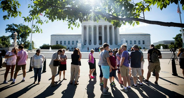 People gather outside the Supreme Court in Washington, DC, USA, 26 June 2017. (EPA Photo)