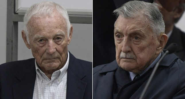 Ford's former executives Pedro Muller (L) and Hector Francisco Jesus Sibilla (R) waits for the veredict in the trial at a court in San Martin, Buenos Aires, on December 11, 2018. (AFP Photos)