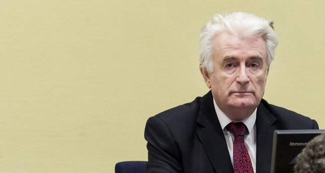 Former Bosnian Serb leader Radovan Karadzic sits in the court room of the International Residual Mechanism for Criminal Tribunals in The Hague, Netherlands, on March 20, 2019. AFP Photo