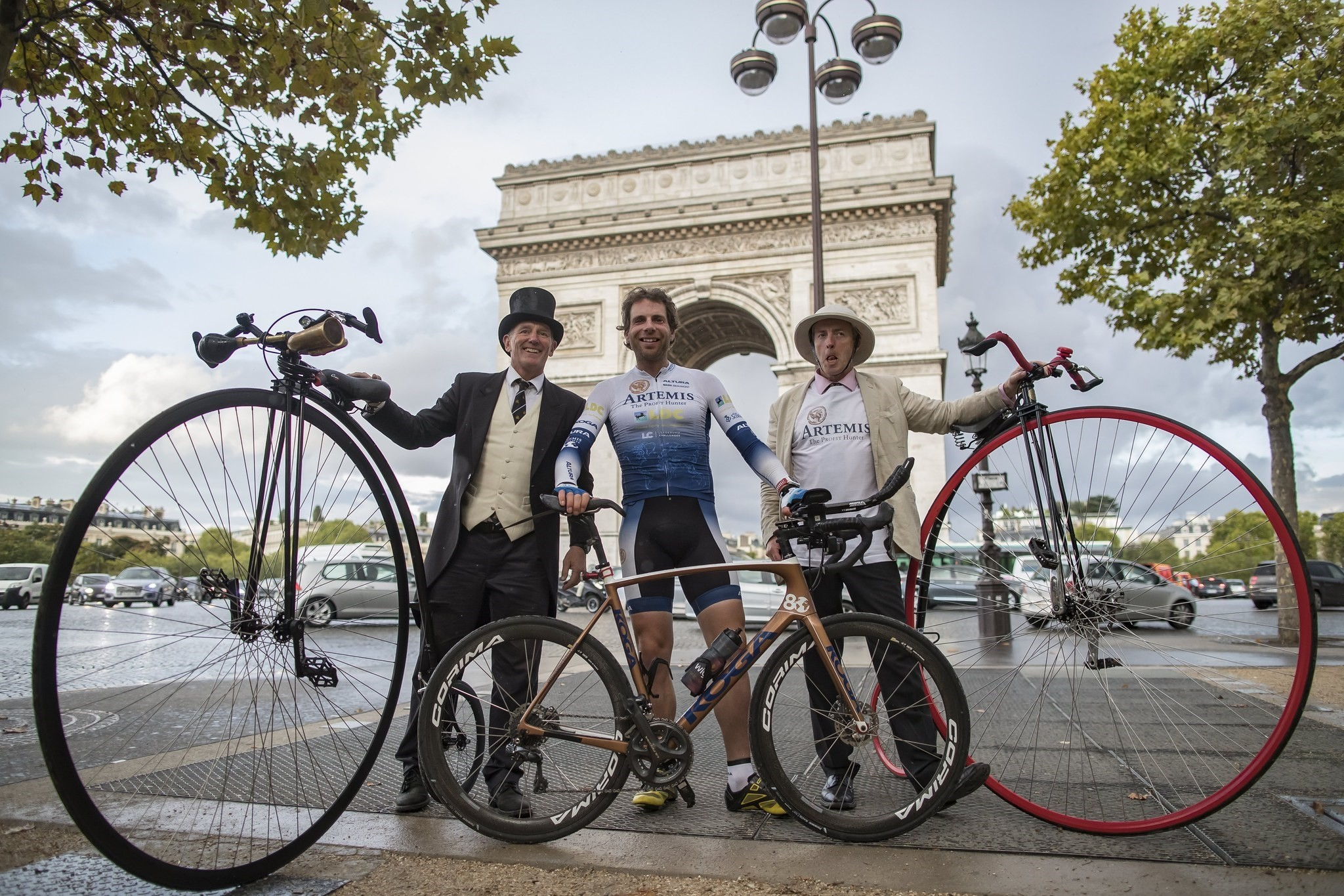 British athlete and adventurer Mark Beaumont poses with men with old bicycles as he arrives in Paris after cycling around the world in a record-setting 78 days. (EPA Photo)