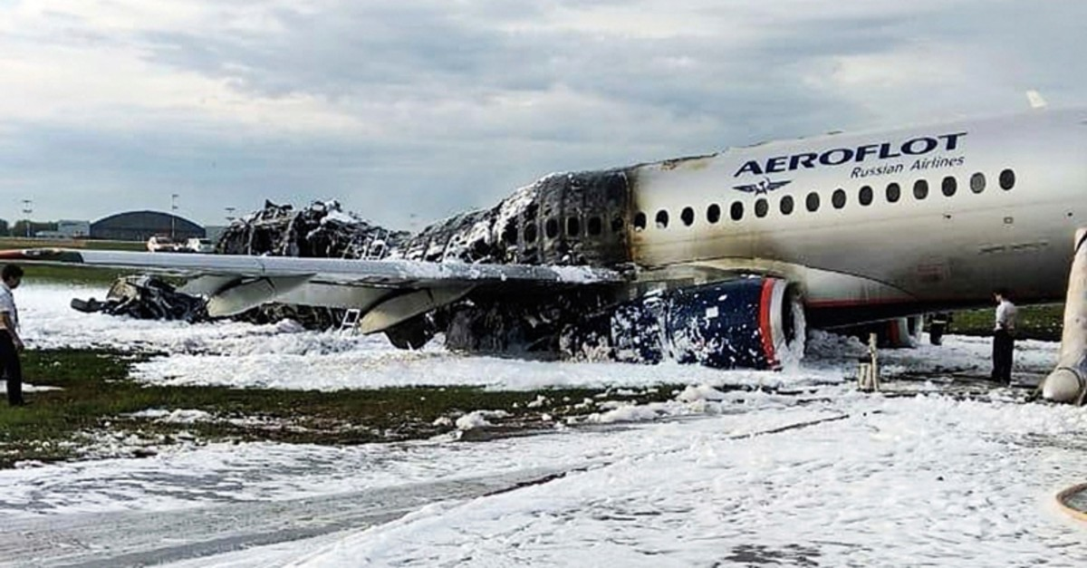 The Sukhoi Superjet 100 aircraft of Aeroflot Airlines is covered in fire retardant foam after an emergency landing in Sheremetyevo airport in Moscow, Russia, Sunday, May 5, 2019. ( AP Photo)