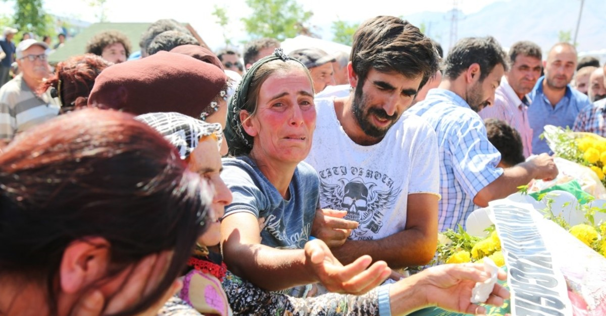 People mourn at the funeral of young siblings killed by the PKK, Tunceli, July 16, 2019.