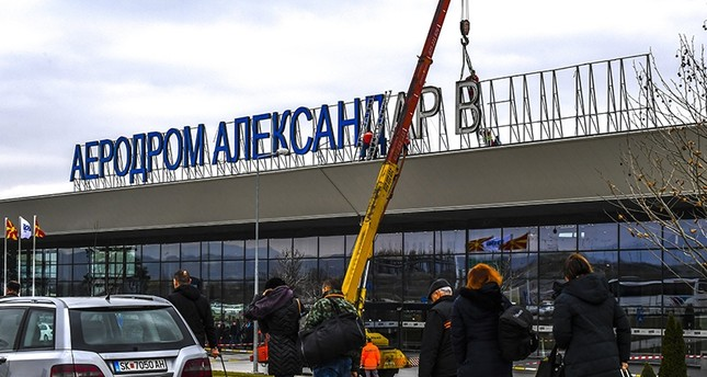 Workers remove the letters of the sign for the airport Alexandar the Great on the airport building near capital of Skopje, The Former Yugoslav Republic of Macedonia, Feb. 24 2018 (EPA Photo)