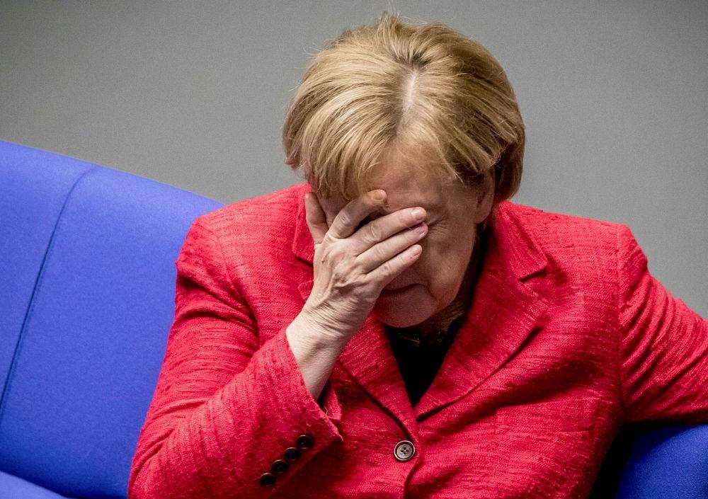 German Chancellor Merkel attends a plenary session of German parliament, Berlin, Nov. 21.