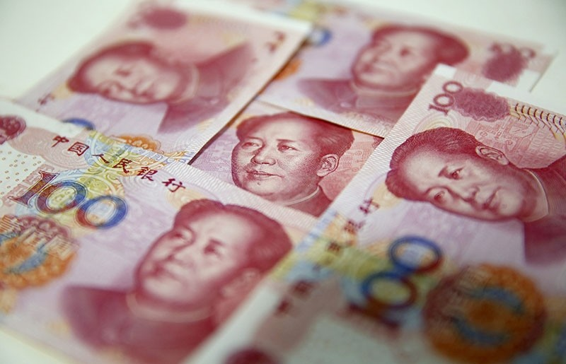 A file picture dated Aug. 12, 2015 shows Chinese yuan banknotes in Beijing, China. (EPA Photo)