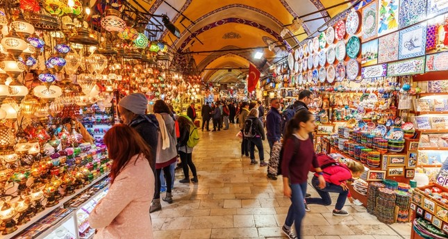 Tourists visit Istanbul's historic Grand Bazaar, one of the city's main tourist attractions.