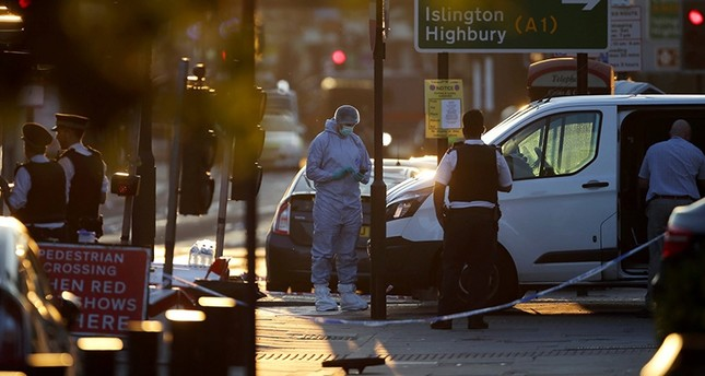 Forensic investigators near the crash site after several people were hit in the Finsbury Park area of north London. (AFP Photo)