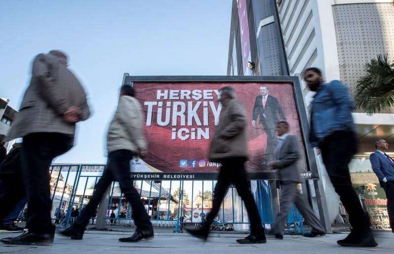 People walk in front of a billboard that reads u201cEverything for Turkeyu201d, Van, eastern Turkey, May 16.