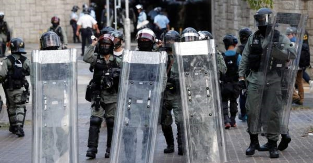Riot police block a street during anti-government protests in Tai Po district, Hong Kong, Oct.13, 2019. (REUTERS Photo)