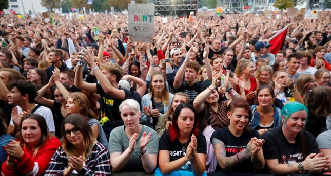 People have a rave in front of the Karl-Marx statute after the We Are More concert to say 'No' to the far right on September 3, 2018 in Chemnitz, eastern Germany. (REUTERS Photo)