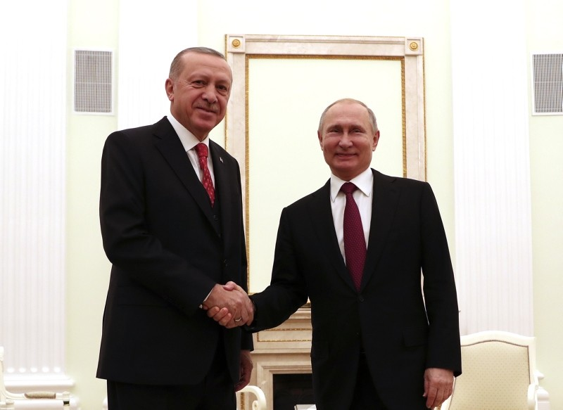 President Recep Tayyip Erdou011fan, left, and Russian President Vladimir Putin shake hands after their meeting in the Kremlin in Moscow, Russia, Wednesday, Jan. 23, 2019. (AA Photo)