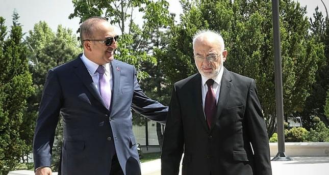 مولود تشاويش أوغلو - وزير الخارجية التركي يسار، إبراهيم الجعفري - وزير الخارجية العراقي يمين. الأناضول