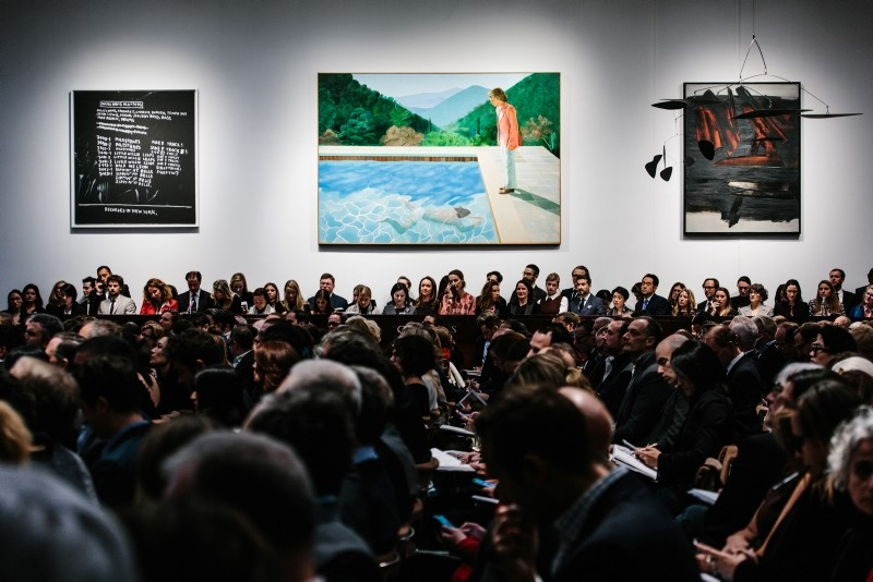 The painting 'Portrait of an Artist (Pool with Two Figures)' by artist David Hockney (C) is displayed at Christie's auction house in New York, U.S., November 2018.(EPA Photo)