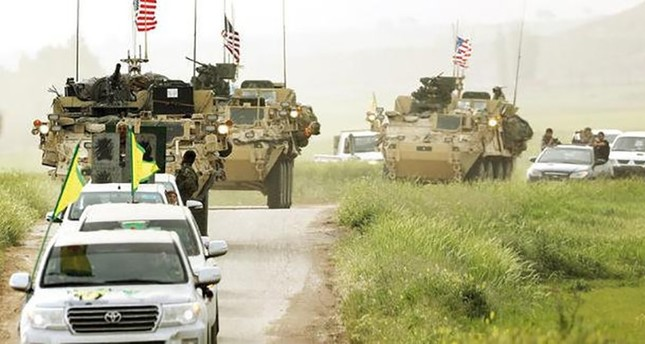 A convoy of U.S. military vehicles patrol with YPG vehicles in the town of Darbasiya near the border with Turkey, in northern Syria, April 28, 2017. (Reuters Photo)