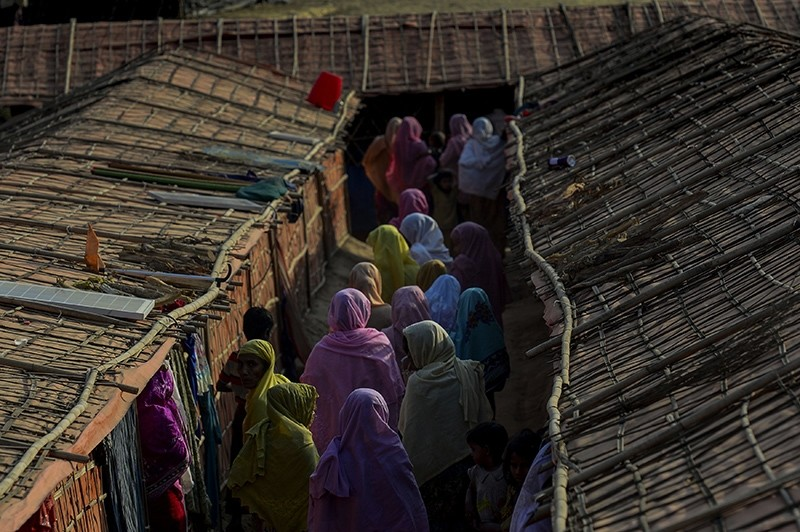 This Jan. 26, 2018 photograph shows Rohingya women walking inside the ,widow's camp, at the Balukhali refugee camp in Bangladesh's Ukhia district. (AFP Photo)