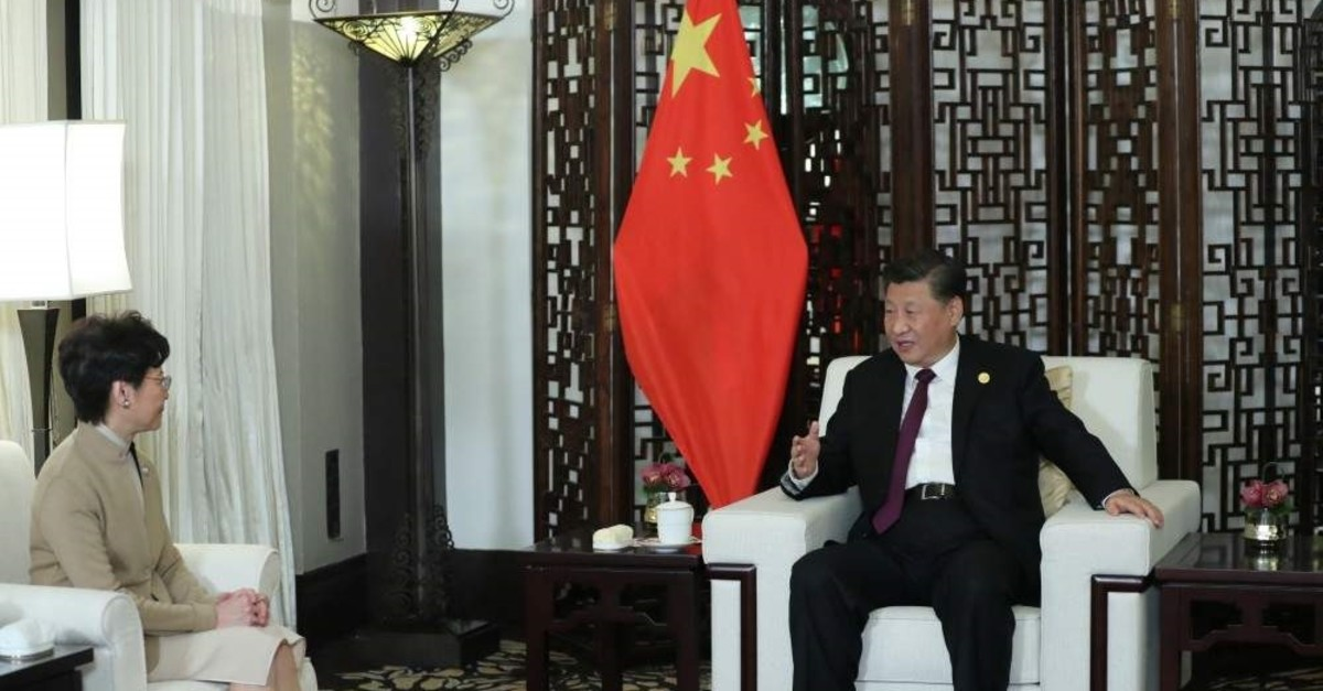 Chinese President Xi Jinping, right, meets Chief Executive of Hong Kong Special Administrative Region (HKSAR) Carrie Lam in Shanghai, China, Nov. 4, 2019. (Reuters Photo)