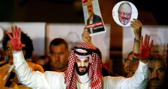 A demonstrator wearing a Mohammed bin Salman mask attends a protest outside the Saudi Consulate in Istanbul, Oct. 25.