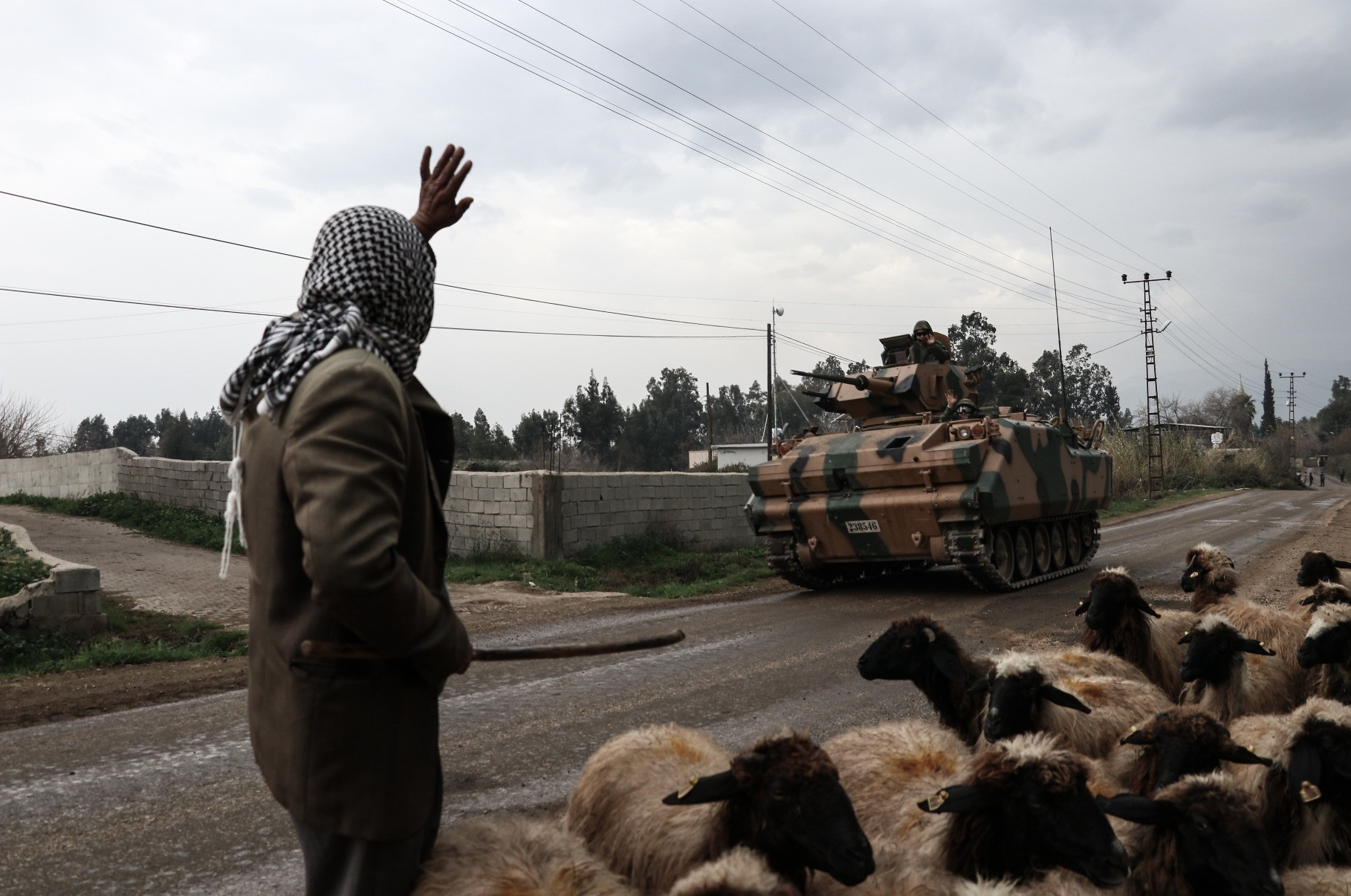 A Syrian shepherd waves to a Turkish soldier as he passes by after Afrin was liberated from YPG terrorists as part of Operation Olive Branch, March 21, Syria.